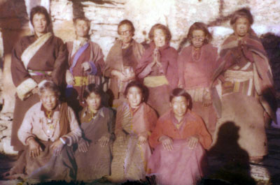 Polaroid picture of the Muktinath nuns in 1980 together with Lama Wangyal.